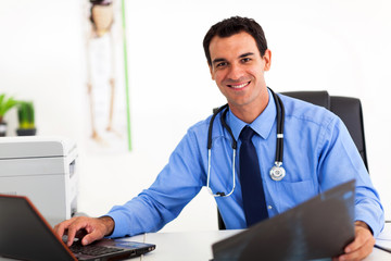 medical doctor working in office