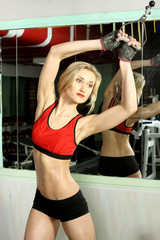 Pretty slender athletic girl in the gym