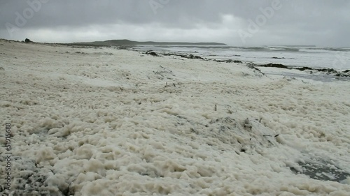Stormy wind with foam on the beach