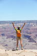 Happy hiker by Grand Canyon south rim cheering