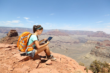 Tablet computer woman hiking in Grand Canyon