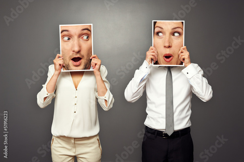 man and woman holding amazed faces