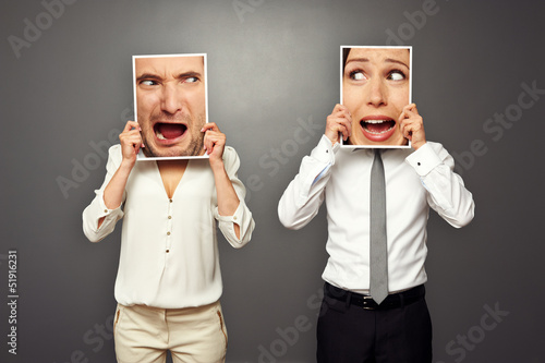 man and woman holding screaming faces