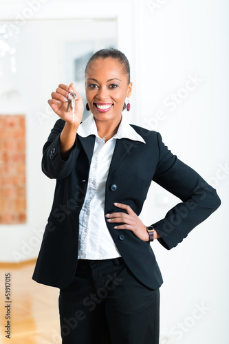 Young realtor with keys in an apartment