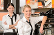 Two waitresses posing in coffee house