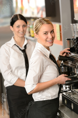 Smiling young waitresses serving coffee restaurant