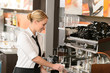 Waitress preparing hot beverage in coffee house
