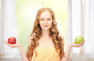 young beautiful woman with green and red apples