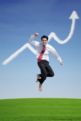 Businessman success jump on profit graph cloud
