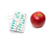 composition with medicaments and apple. selective focus