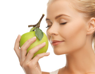 woman smelling apple