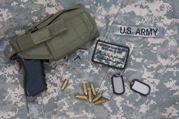 US  army concept with dog tags, camouflaged uniform with patches