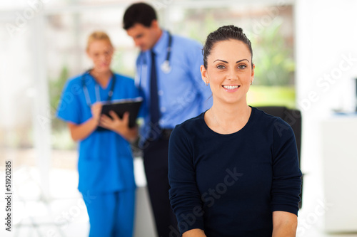 woman waiting for checkup in doctor's office