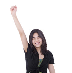Confident young teen girl with one arm raised in success