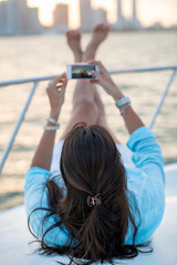 Woman taking picture on a yacht