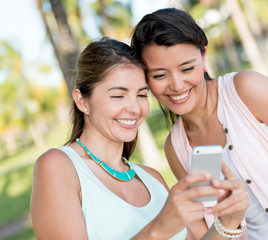 Girls using app on a mobile phone