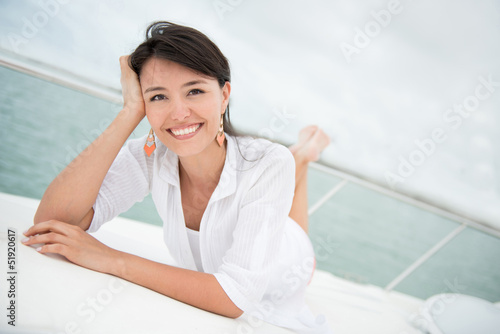 Relaxed woman sailing