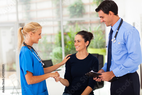 woman handshaking with nurse after checkup