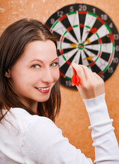woman playing darts