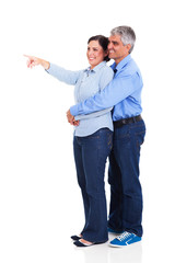 mature woman pointing at copyspace with husband
