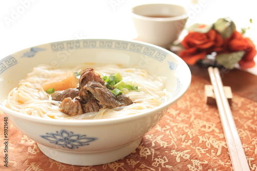 chinese cuisine, simmered beef tendon on hofan rice noodles