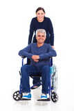 middle aged woman with disabled husband