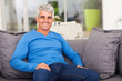 middle aged man relaxing on sofa
