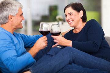 middle aged couple enjoying wine