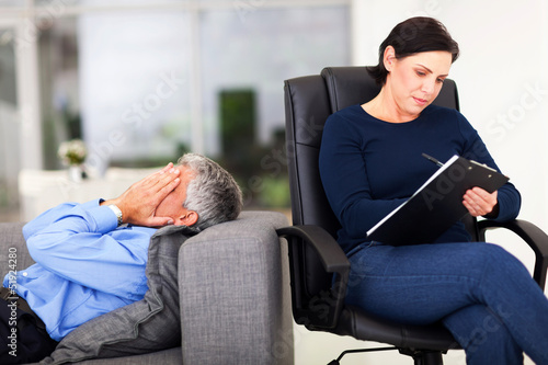middle aged man crying during session with therapist