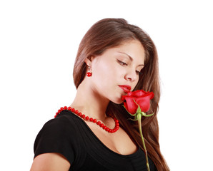 Pensive beautiful woman looks at red rose isolated on white