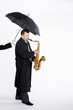 Saxophonist under an umbrella