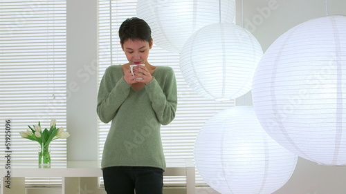Cute Asian woman drinking tea