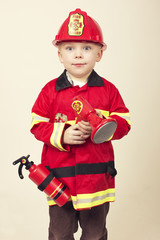 Cute Young Boy in a Fireman s Costume
