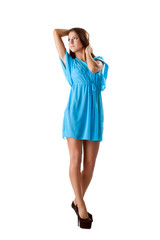 Charming brunette posing in blue nightgown