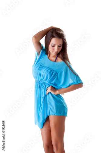 Portrait of pretty girl posing in blue nightdress