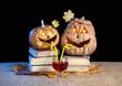 Funny Halloween pumpkins drinking wine