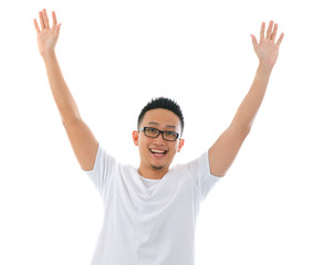 casual asian man jumping celebrating success with isolated white