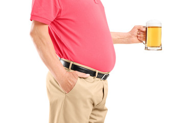 A man with belly holding a beer glass