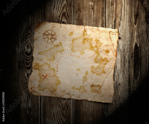 old treasure map  on wooden background