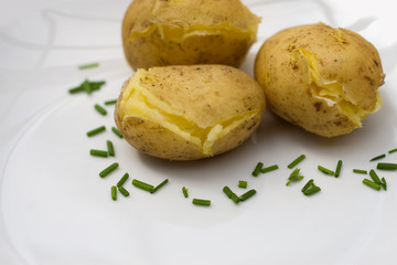 baked potatoes on white plate