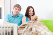 Couple near oil heater