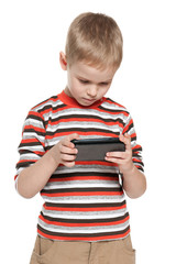 Pensive boy with a smartphone