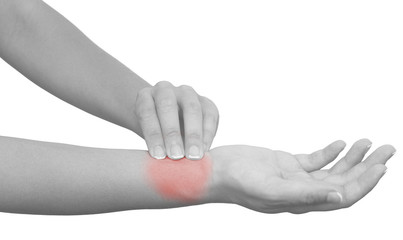 Hand taking radial artery pulse.