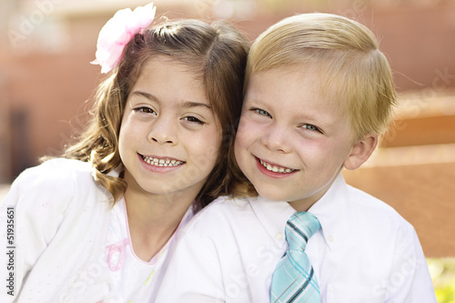 Portrait of two cute kids formal dress