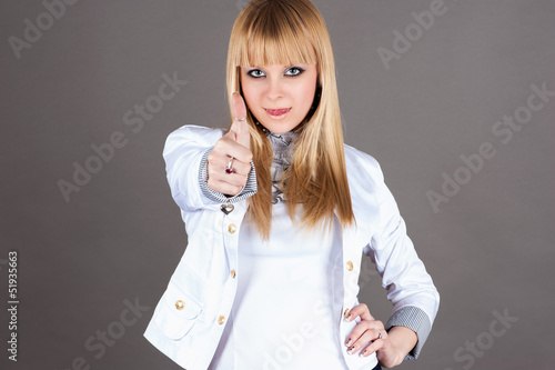 modern beautiful woman showing thumbs up gesture