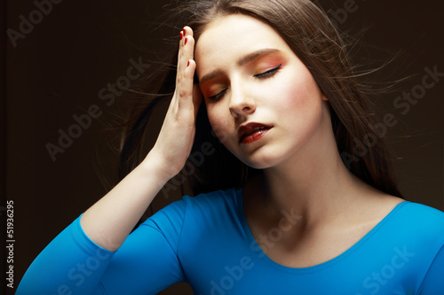Distress. Woe. Upset Woman Touching her Forehead. Difficulties