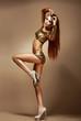 Dance. Nightclub. Woman in Golden Shorts. Fancy Dress Party