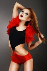 Showgirl. Red Hair Asian Woman with Fantastic Makeup in Clubwear