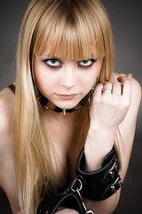 portrait of the blond with leather handcuffs