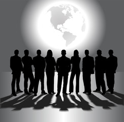 silhouettes of business people on the background of the planet